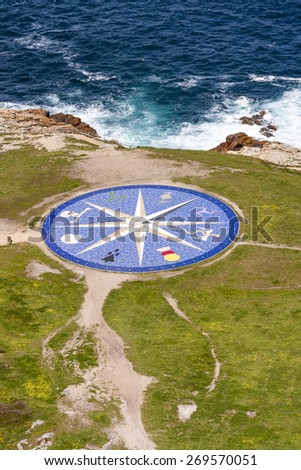 Compass rose in Corunna, Spain pointing the front corners of the Tower of Hercules, the oldest operating lighthouse in the world - stock photo