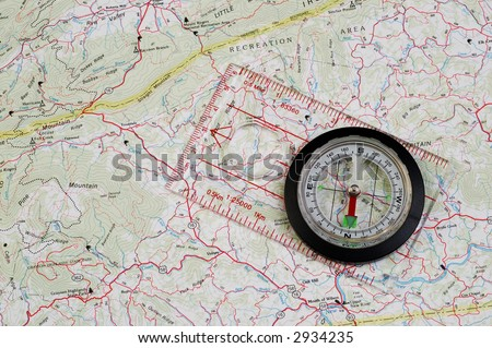 Compass with a clear base on a map
