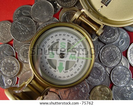 compass with coins