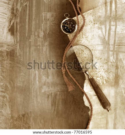 compass with magnifying glass on wooden background
