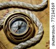 Compass with rope on the old map - stock photo