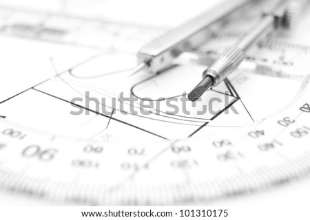 Compasses and the drawing.