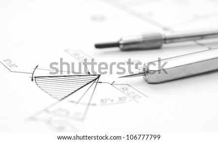 Compasses and the drawing . - stock photo