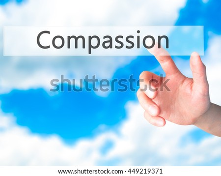 Compassion - Hand pressing a button on blurred background concept . Business, technology, internet concept. Stock Photo - stock photo