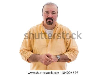 Compassionate sincere middle-aged man standing with clasped hands looking at the camera with an expression of empathy, isolated on white - stock photo