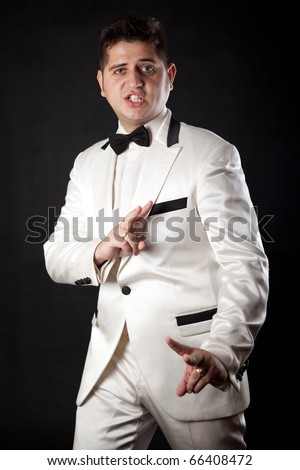 compere man in an overwhites with a butterfly in appearance - stock photo