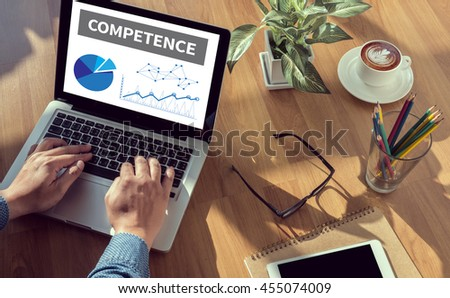 COMPETENCE  ( Skill Ability Proficiency Accomplishment) man hand on table Business, coffee, Split tone - stock photo