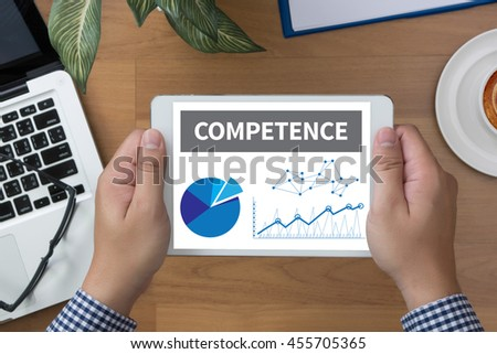 COMPETENCE  ( Skill Ability Proficiency Accomplishment) man hand Tablet and coffee cup - stock photo