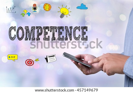 COMPETENCE  ( Skill Ability Proficiency Accomplishment) person holding a smartphone on blurred cityscape background - stock photo