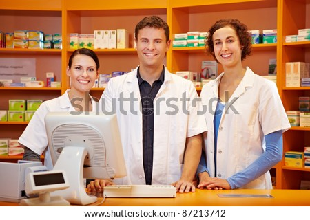 Competent pharmacy team with pharmacist and pharmacy technicians - stock photo