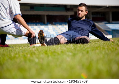 competition Action run and jump Duel of football players at soccer ball stadium - stock photo