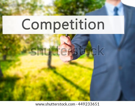 Competition - Business man showing sign. Business, technology, internet concept. Stock Photo - stock photo
