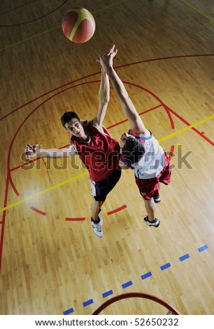 competition cencept with people who playing and exercise  basketball sport  in school gym