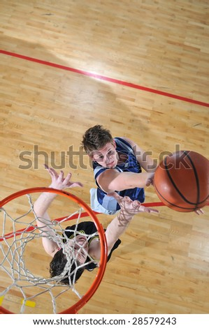 competition cencept with people who playing basketball in school gym - stock photo