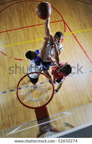 competition concept with people who playing and exercise  basketball sport  in school gym - stock photo
