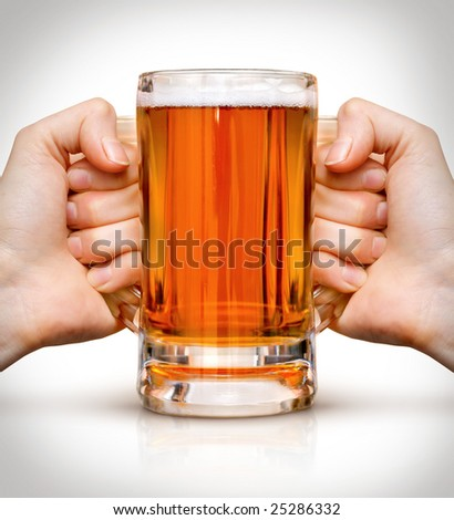 competition of two human hands with beer in glass. Clipping path is included - stock photo