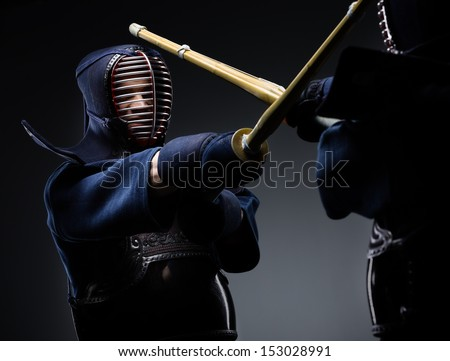 Competition of two kendo fighters. Japanese martial art of sword fighting - stock photo