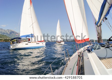 "Competition on yachts. Tivat, Montenegro - 26 April, 2016. Regatta ""Russian stream"" in God-Katorskaya bay of the Adriatic Sea off the coast of Montenegro. - stock photo"