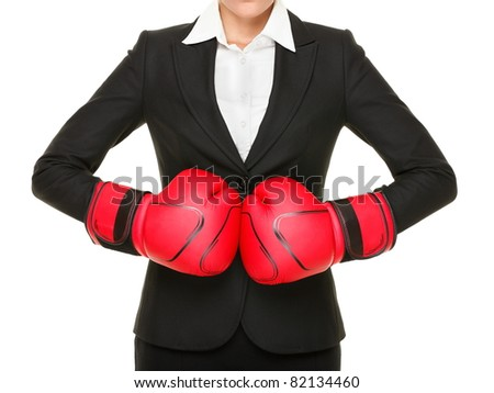 Competition ready - business concept. Businesswoman punching red boxing gloves together isolated on white background. - stock photo