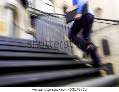Competition, rent a person up a flight of stairs - stock photo