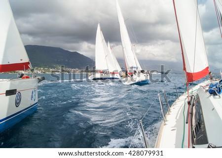 "Competitions sea yachts. Tivat, Montenegro - 28 April, 2016 Regatta ""Russian stream"" in God-Katorskaya bay of the Adriatic Sea off the coast of Montenegro. - stock photo"