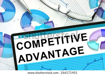 Competitive Advantage  on tablet with graphs. Business concept.                 - stock photo