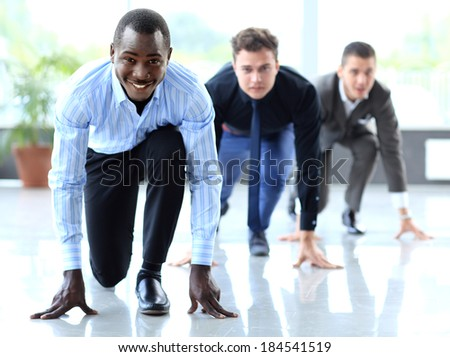 Competitive businessmen ready to start running. Concept of leadership and success  - stock photo