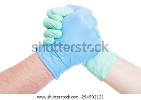 Competitive doctors arms wrestling on white background - stock photo
