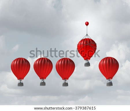 Competitive edge and business advantage concept as a group of hot air balloons racing to the top but an individualleader with a small balloon attached giving the winning competitor an extra boost. - stock photo