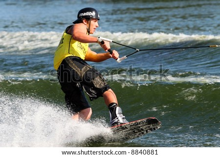 Competitor at a wake boarding competition. - stock photo