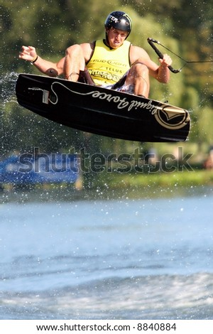 Competitor in mid air at a wake boarding competition. - stock photo