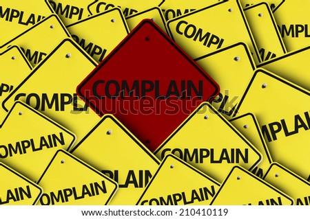 Complain written on multiple road sign - stock photo