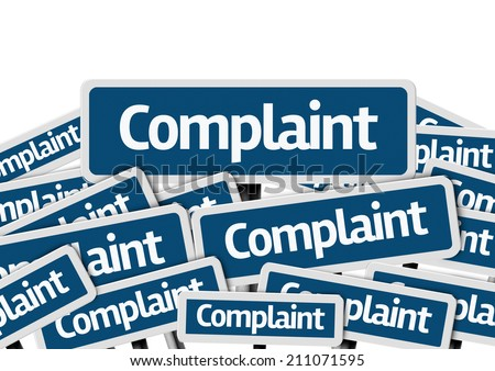 Complaint written on multiple blue road sign  - stock photo