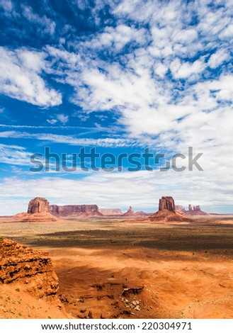 Complementary colours blue and orange in this iconic view of Monument Valley, USA