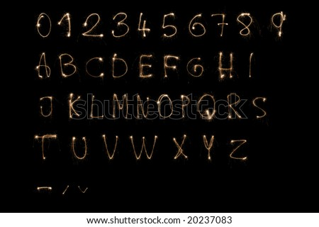 Complete alphabet made by sparkler. - stock photo