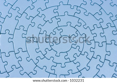 complete blue jigsaw - pieces fitting together in form of a spiral