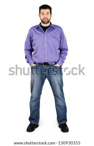 Complete body shot of a tall caucasian man in jeans over white - stock photo