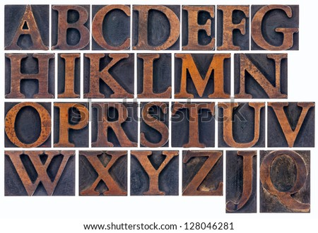 complete English alphabet  in vintage  wood type - a  collage of 26 isolated letterpress printing blocks stained by ink - stock photo