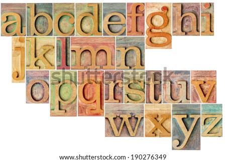 complete English lowercase alphabet - a collage of 26 isolated antique wood letterpress printing blocks, stained by color inks - stock photo