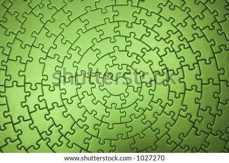 complete green jigsaw wide angle - pieces fitting together in form of a spiral - stock photo