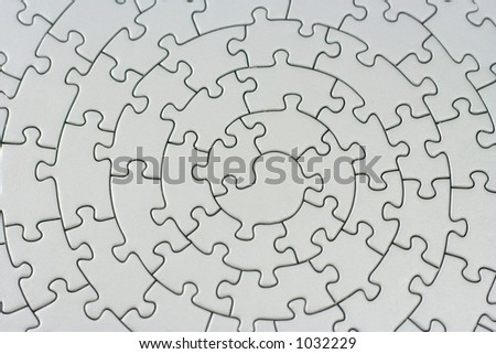 complete grey jigsaw - pieces fitting together in form of a spiral