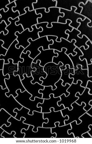 complete jigsaw in black and white - pieces fitting together in form of a spiral