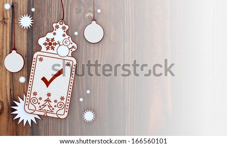 completed, illustration of a christmas card with check label in front of a wooden background with gradient to white