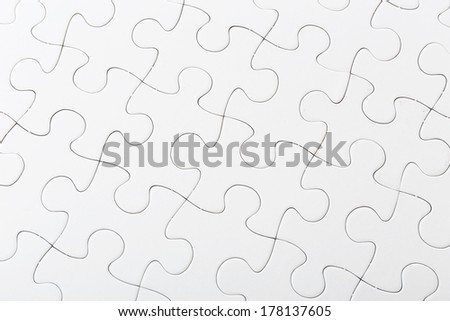 Completed white puzzle - stock photo