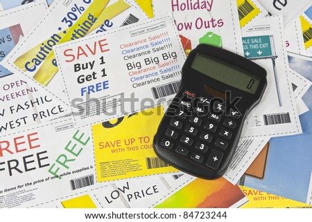 Completely fake fashion coupons with scissor.  Fictional bar codes.  All coupons were created by the photographer.  No real ads were used.  Photographs in the coupons are the photographers work. - stock photo