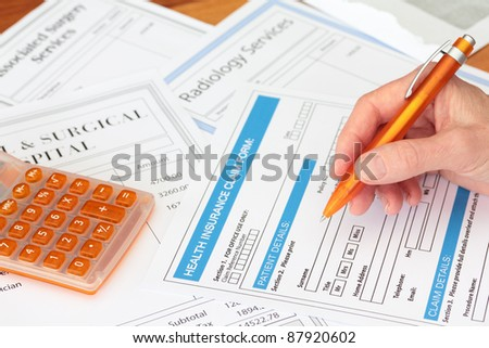 Completing a Health Insurance Claim with Surgery Bills - stock photo