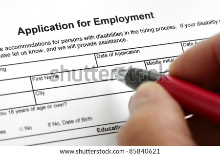 Completing an job application form with focus on heading - stock photo
