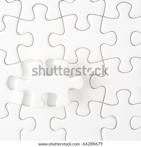 Completing the missing Jigsaw puzzle - stock photo