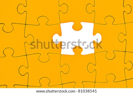 Completing the missing Jigsaw puzzle concept for business / completing the team with final person - stock photo