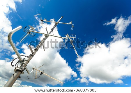 complex antenna to receive digital TV and radio signals at the antenna mast - a common TV antenna (to receive signals: DVB-T, DVB-T2, DAB, FM from 4 directions, big perspective) - stock photo